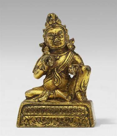 A Sinotibetan gilt bronze miniature figure of Jambhala. 18th/19th century
