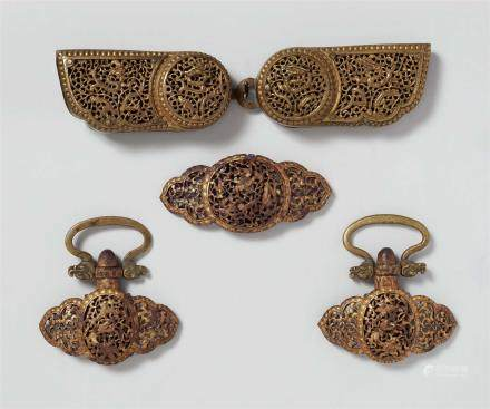 Three Tibetan gold damascened iron belt ornaments. 17th/18th century And Tibetan brass belt-buckle