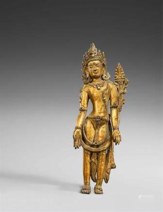 A Tibetan gilt bronze figure of Manjushri. 15th century