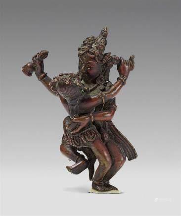 A Tibetan bronze figure of a bodhisattva in yab-yum. 16th/17th century