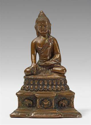 A Kashmiri bronze figure of Buddha Shakyamuni. 16th/17th century