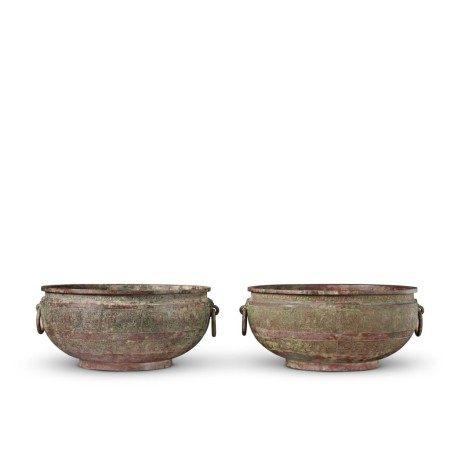A pair of archaic bronze water basins (Jian), Eastern Zhou dynasty, late 6th - early 5th century BC | 東周 公元前六世紀末至五世紀初 青銅交龍紋鋪首耳鑒一對