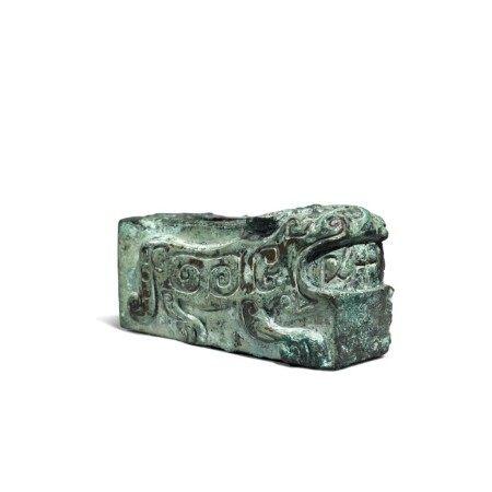 An archaic bronze 'tiger' fitting, Shang dynasty | 商 青銅虎紋部件