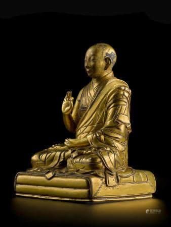 A GILT COPPER ALLOY FIGURE OF THE FIRST PANCHEN LAMA, LOBSANG CHOKYI GYALTSEN TIBET, EARLY-MID 17TH CENTURY