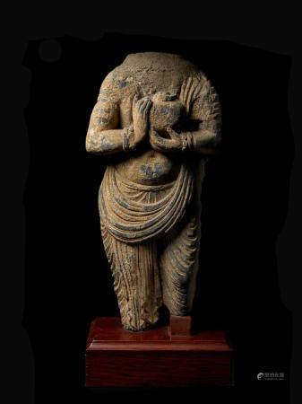 A SCHIST TORSO OF A BUDDHIST DONOR ANCIENT REGION OF GANDHARA, 3RD/4TH CENTURY