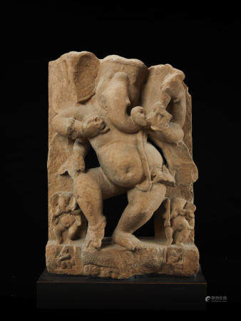 A SANDSTONE FIGURE OF DANCING GANESHA NORTHERN INDIA, 10TH/11TH CENTURY