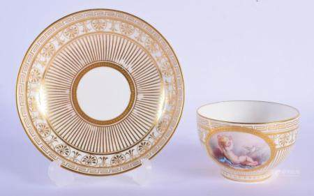 Late 19th c. Minton teacup and saucer with classically gilded salmon ground, the cup painted with a naked child sitting on a cloth. Cup 5.5cm high, Saucer 13.5cm diameter (2)