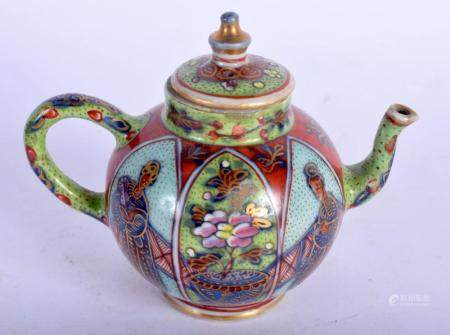 AN EARLY 18TH CENTURY CHINESE PORCELAIN CLOBBERED TEAPOT AND COVER Kangxi/Yongzheng. 10 cm wide.