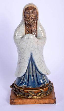 AN 18TH/19TH CENTURY CHINESE GE TYPE FIGURE OF AN IMMORTAL modelled in robes upon a later bronze mounted base. 24 cm high.