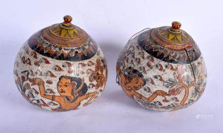 AN UNUSUAL PAIR OF 19TH CENTURY CARVED AND PAINTED MIDDLE EASTERN JARS AND COVERS painted with figures. 15 cm x 12 cm.