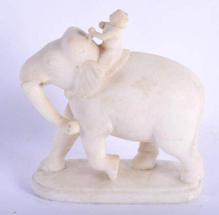 A LATE 19TH CENTURY INDIAN CARVED MARBLE FIGURE OF A ROAMING ELEPHANT modelled with an attendant upon an oval base. 19 cm x 15 cm.