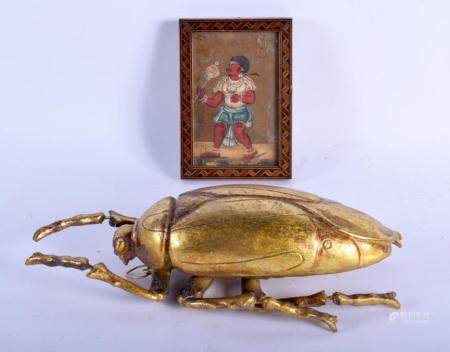 AN UNUSUAL 19TH CENTURY INDIAN MICA MINERAL PAINTED PORTRAIT OF A MALE together with a gilded beetle. Largest 26 cm x 12 cm. (2)