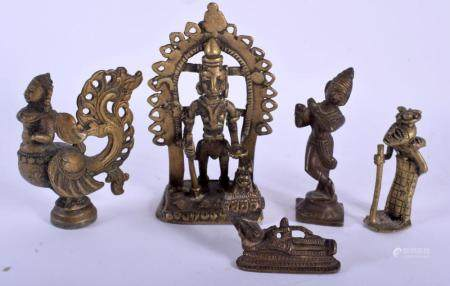 FIVE 19TH CENTURY INDIAN BRONZE BUDDHISTIC DEITIES modelled in various forms and sizes. Largest 11 cm x 7 cm. (5)