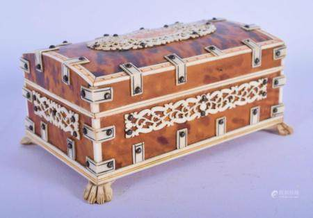 A 19TH CENTURY ANGLO INDIAN CARVED IVORY AND TORTOISESHELL CASKET modelled with paw feet. 12 cm x 6 cm.