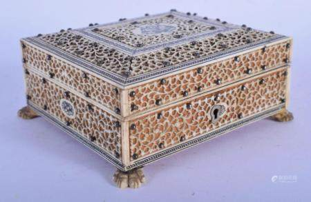 A 19TH CENTURY ANGLO INDIAN CARVED IVORY AND SANDALWOOD CASKET. 11 cm square.