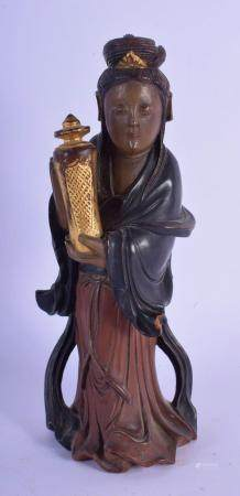 AN 18TH/19TH CENTURY CHINESE POLYCHROMED LACQUER FIGURE OF AN IMMORTAL modelled holding a temple vase and cover. 18 cm high.