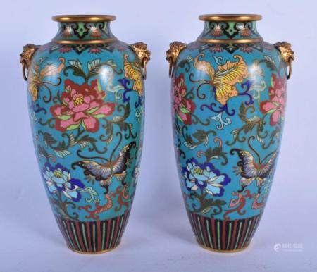 A PAIR OF 19TH CENTURY CHINESE CLOISONNE ENAMEL VASES Qing, decorated with foliage and butterflies. 17 cm high.