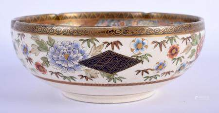 A 19TH CENTURY JAPANESE MEIJI PERIOD SATSUMA BARBED BOWL painted with geisha in landscapes. 13 cm wide.