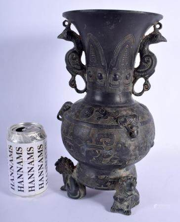 A LARGE CHINESE TWIN HANDLED BRONZE VASE 20th Century, modelled in the archaic style with mask heads. 32 cm x 10 cm.