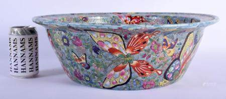 A LARGE MID 20TH CENTURY CHINESE FAMILLE ROSE PORCELAIN WASH BASIN modelled in the Daoguang style with moths and butterflies. 35 cm x 14 cm.