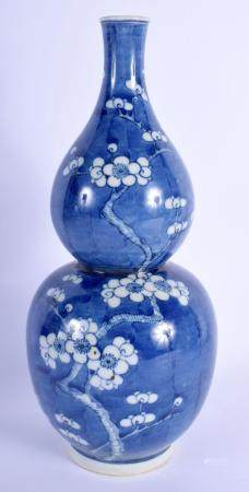 A CHINESE BLUE AND WHITE PORCELAIN DOUBLE GOURD PORCELAIN VASE 20th Century, painted with prunus. 31 cm high.