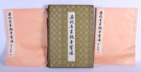 A CHINESE PAINTING AND WATERCOLOUR REFERENCE BOOK with silk binding. 40 cm x 30 cm.