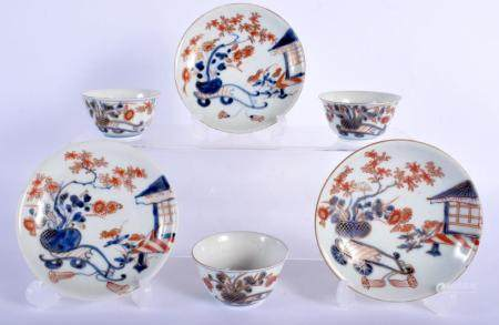 THREE 18TH CENTURY JAPANESE EDO PERIOD IMARI TEABOWLS AND SAUCERS painted with a building and landscapes. 11.5 cm diameter. (6)