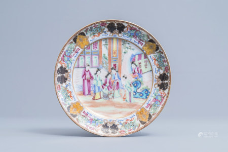 A Chinese Canton famille rose plate with a court scene and auspicious symbols, 19th C.