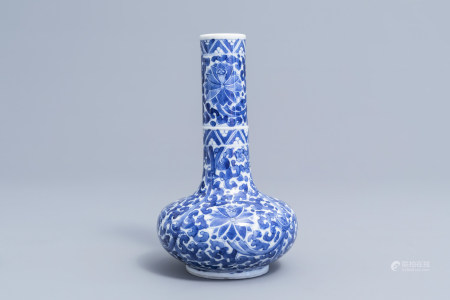 A Chinese blue and white 'lotus scroll' bottle vase, Wanli mark, 19th C.