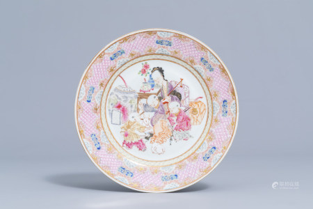 A Chinese famille rose Yongzheng style plate with figures and rabbits in an interior, 19th/20th C.