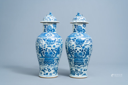 A pair of Chinese blue and white vases and covers with boys and antiquities, 19th C.