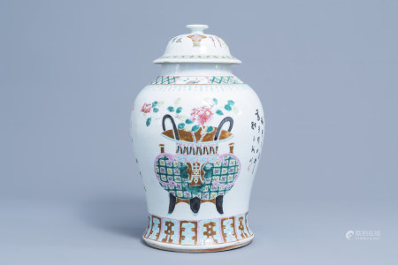 A Chinese famille rose vase and cover with flower baskets, 19th C.