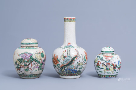 A Chinese bottle shaped Nanking crackle glazed famille verte vase and two jars and covers with warrior scenes, 19th/20th C.