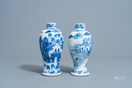 Two Chinese blue and white baluster shaped vases with an animated mountain landscape all around, Kangxi mark, 19th C.