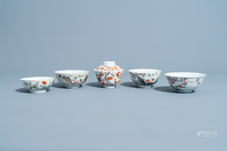 Four various Chinese famille rose bowls and one bowl and cover with floral design, 19th/20th C.