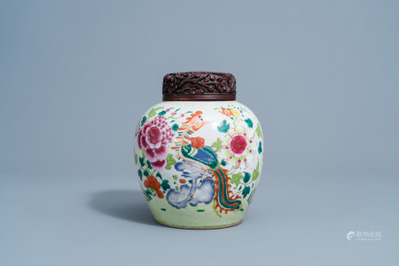 A Chinese famille rose jar and cover with a phoenix among blossoming branches, 19th C.