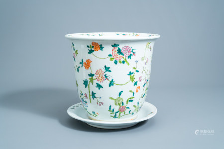 A Chinese famille rose jardiniere on stand with floral design, 20th C.