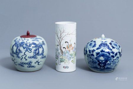 A Chinese famille rose hat stand with ladies in a garden and two blue and white celadon ground jars and covers, 19th/20th C.