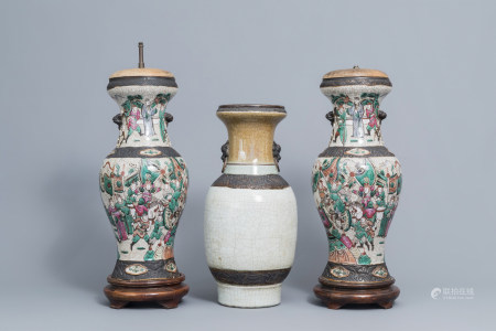 A pair of Chinese Nanking crackle glazed famille rose vases with warrior scenes and a Nanking celadon vase, 19th C.