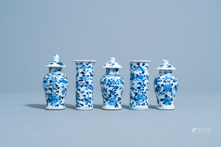 A Chinese blue and white five-piece garniture with floral design, 19th C.
