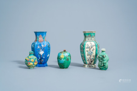 A Chinese sancai glazed relief moulded jar and cover, two snuff bottles and two vases with floral design and antiquities, 19th/20th C.