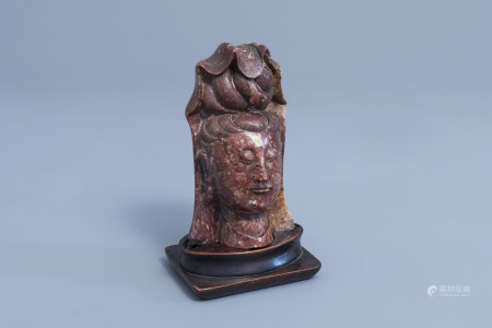 A Chinese carved soapstone bust of Guanyin, 19th C