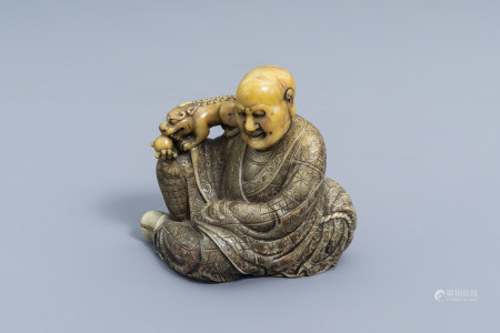 A Chinese carved Shoushan soapstone figure of a Luohan, 19th/20th C.