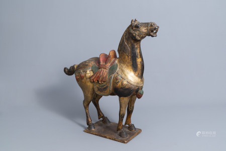A large Chinese carved and polychromed wooden Tang style horse, 20th C.