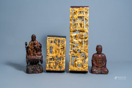 Two Chinese lacquered and gilt wood figures and two reticulated panels, 19th/20th C.
