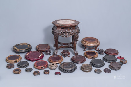 A collection of Chinese wooden stands and a carved wooden stand with marble top, 19th/20th C.