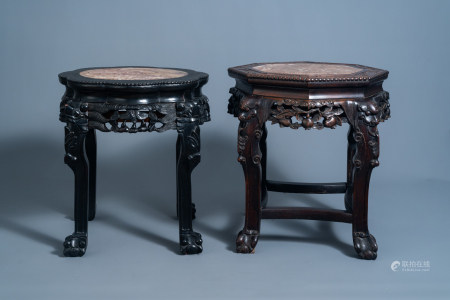 Two Chinese carved wooden stands with marble top, 19th/20th C.