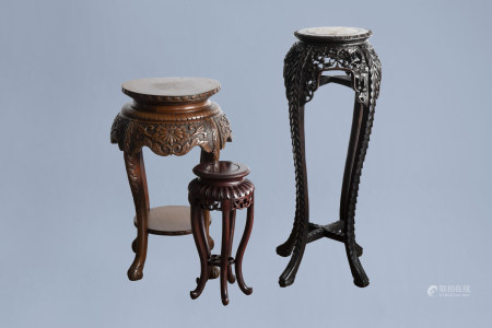Three Chinese wood stands, one with marble top, 20th C.