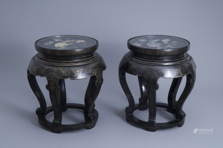 A pair of Chinese black lacquered wooden stands with a soapstone relief of a bird on blossoming branches, 20th C.