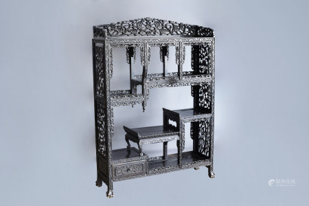 A Chinese open worked wooden display cabinet with floral design, 19th/20th C.
